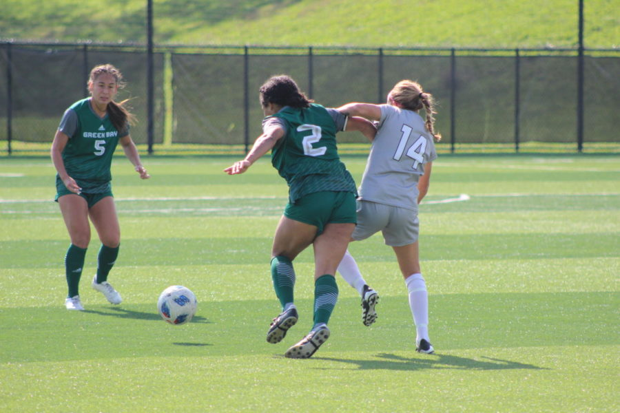 NKU midfielder Lindsey Meyer (14) battles with a Green Bay player for the ball during NKUs 1-0 loss on Saturday.