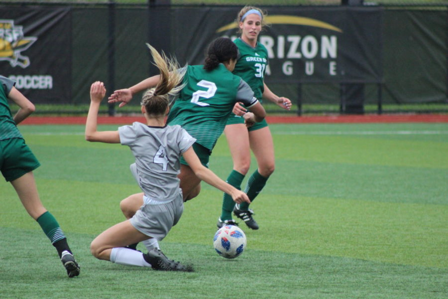 NKU midfielder Sofia Wilmes (4) goes into a slide during the Norse 1-0 loss to Green Bay on Saturday.