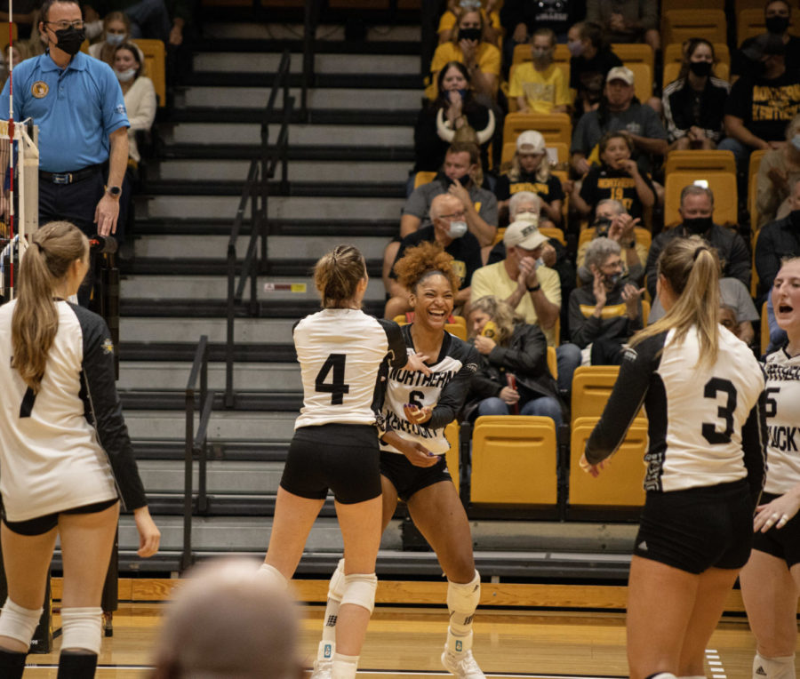 Members of the NKU volleyball team celebrate a point during the 3-1 win over Oakland on Friday.